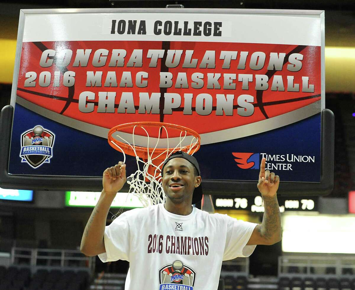 Iona's Rickey McGill cuts the net after his beat Monmouth in the MAAC men's championship game at the Times Union Center on Monday, March 7, 2016 in Albany, N.Y.
