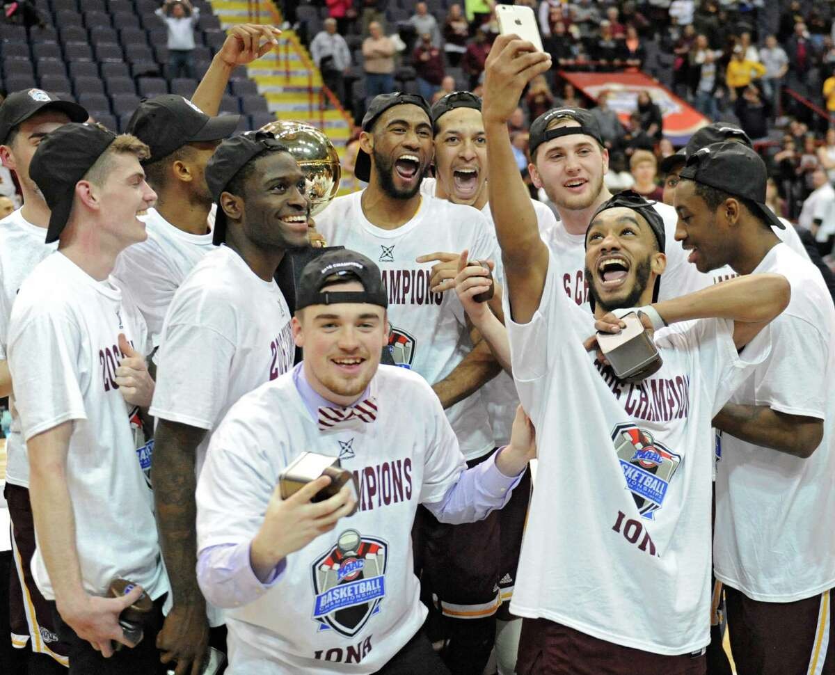 Iona celebrates after beating Monmouth in the MAAC men's championship game at the Times Union Center on Monday, March 7, 2016 in Albany, N.Y.