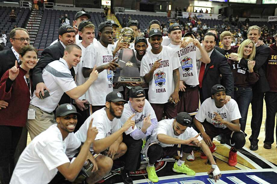 Iona celebrates after beating Monmouth in the MAAC men's championship game at the Times Union Center on Monday, March 7, 2016 in Albany, N.Y. Photo: Lori Van Buren / 10035663A