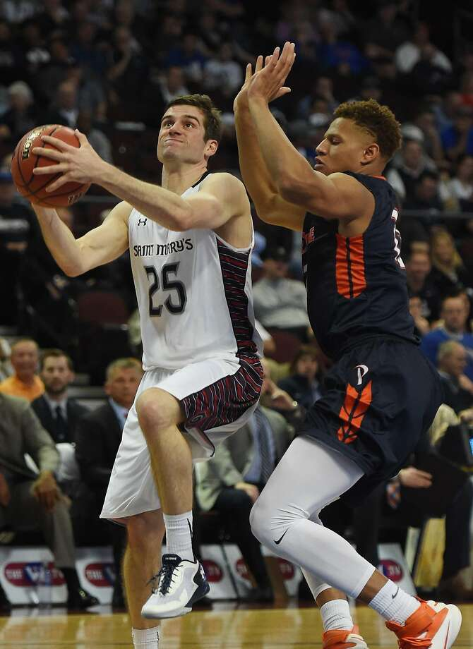 LAS VEGAS, NV - MARCH 07:  Joe Rahon #25 of the Saint Mary's Gaels drives to the basket against Kameron Edwards #13 of the Pepperdine Waves during a semifinal game of the West Coast Conference Basketball tournament at the Orleans Arena on March 7, 2016 in Las Vegas, Nevada.  (Photo by Ethan Miller/Getty Images) Photo: Ethan Miller, Getty Images