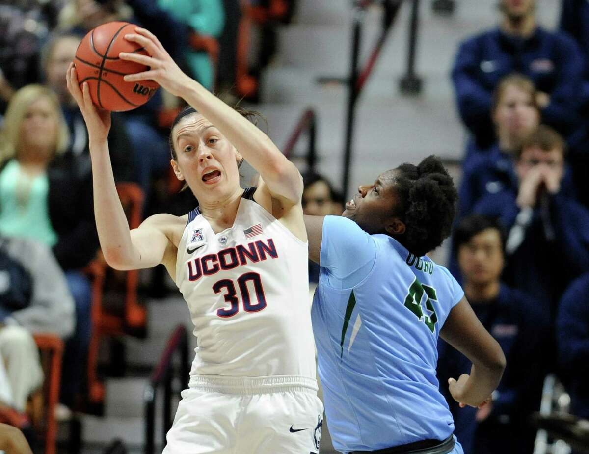 Connecticut?'s Breanna Stewart, left, grabs a rebound over Tulane?'s Chinwe Duru, right, during the first half of an NCAA college basketball game in the American Athletic Conference tournament semifinals at Mohegan Sun Arena, Sunday, March 6, 2016, in Uncasville, Conn. UConn won 82-35. (AP Photo/Jessica Hill) ORG XMIT: CTJH114