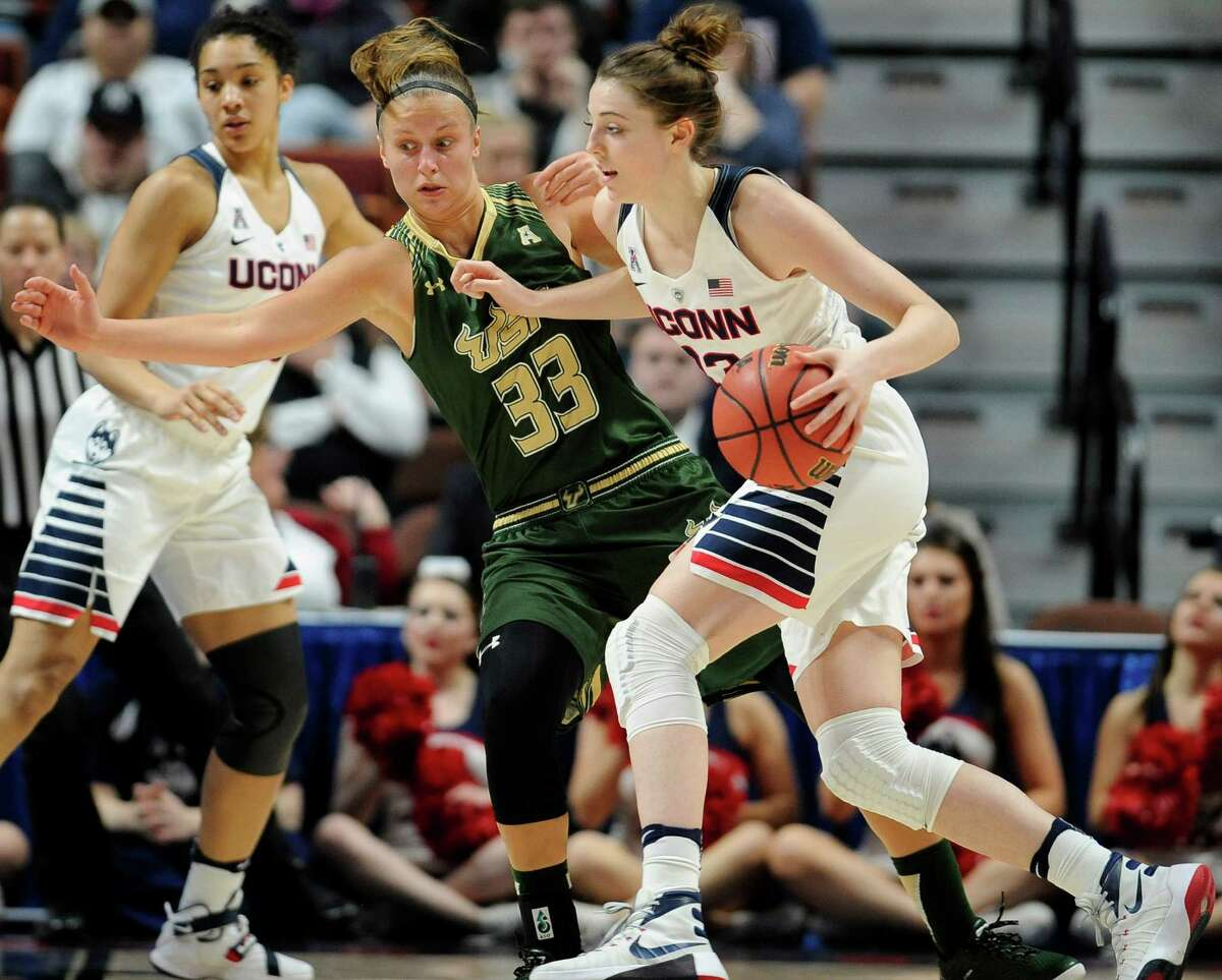 Connecticut?'s Katie Lou Samuelson dribbles past South Florida?'s Kitija Laksa (33) during the second half of an NCAA college basketball game in the American Athletic Conference tournament finals at Mohegan Sun Arena, Monday, March 7, 2016, in Uncasville, Conn. (AP Photo/Jessica Hill) ORG XMIT: CTJH108