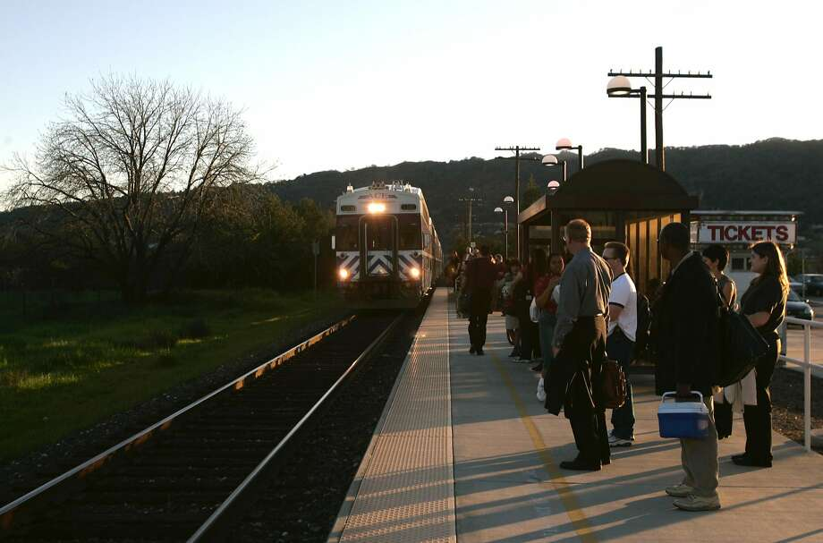 Passengers wait for an Altamont Commuter Express (ACE) train to arrive in Pleasanton for the commute home toward Stockton. Photo: Deanne Fitzmaurice, SFC
