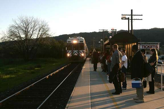 ace14_102_df.JPG Passengers wait for the Altamont Commuter Express (ACE) train to arrive in Pleasanton for their commute home toward Stockton. Deanne Fitzmaurice / The Chronicle