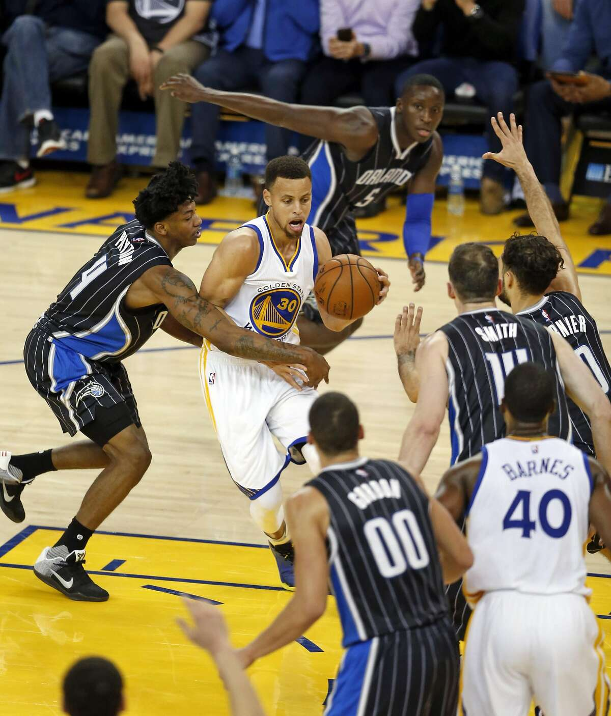 Golden State Warriors' Stephen Curry dribbles among 5 Orlando Magic players in 3rd quarter during NBA game at Oracle Arena in Oakland, Calif., on Monday, March 7, 2016.