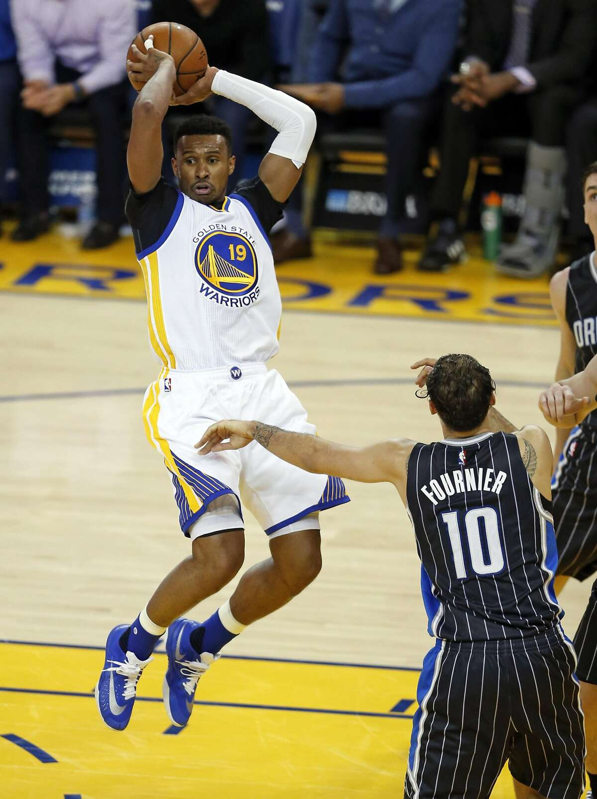Golden State Warriors' Leandro Barbosa passes against Orlando Magic's Evan Fournier in 3rd quarter during NBA game at Oracle Arena in Oakland, Calif., on Monday, March 7, 2016.