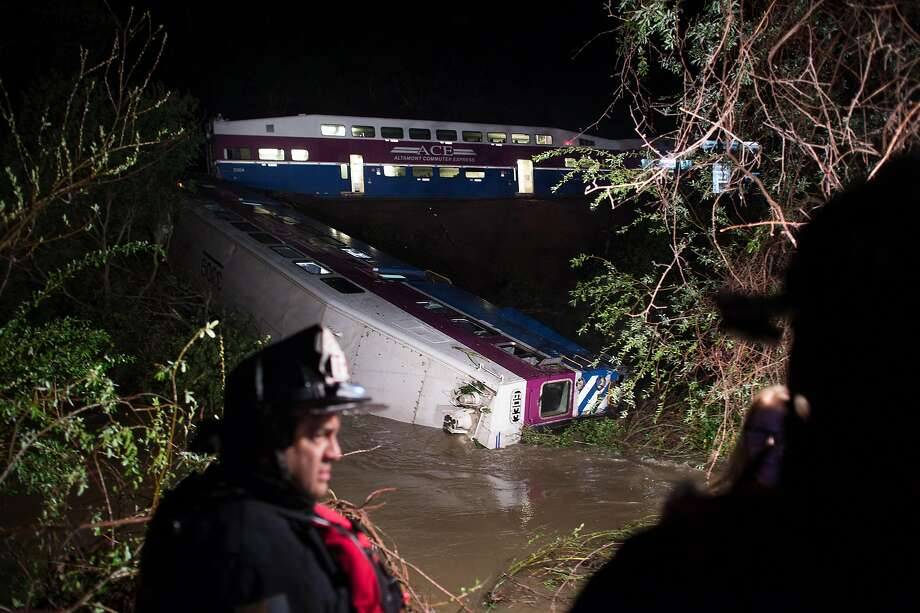 An ACE commuter train rests partially submerged in a creek following a derailment on Monday, March 7, 2016, in Sunol, Calif. Photo: NOAH BERGER / SAN FRANCISCO CHRONICLE