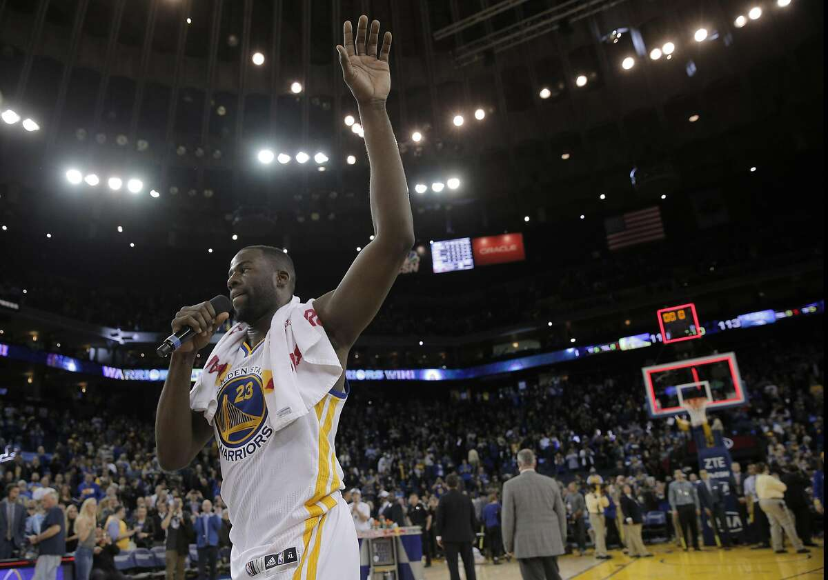 Draynond Green (23) thanks the fans for their support in winning 45 straight home games after the Golden State Warriors played the Orlando Magic at Oracle Arena in Oakland, Calif., on Monday, March 7, 2016.