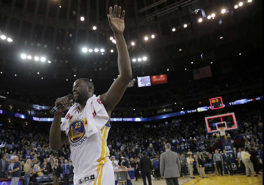 Draynond Green (23) thanks the fans for their support in winning 45 straight home games after the Golden State Warriors played the Orlando Magic at Oracle Arena in Oakland, Calif., on Monday, March 7, 2016. Photo: Carlos Avila Gonzalez Carlos Gonzalez, The Chronicle