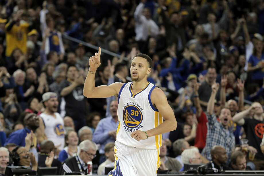 Stephen Curry (30) gestures after hitting a three point shot in the second half as the Golden State Warriors played the Orlando Magic at Oracle Arena in Oakland, Calif., on Monday, March 7, 2016. Photo: Carlos Avila Gonzalez Carlos Gonzalez, The Chronicle