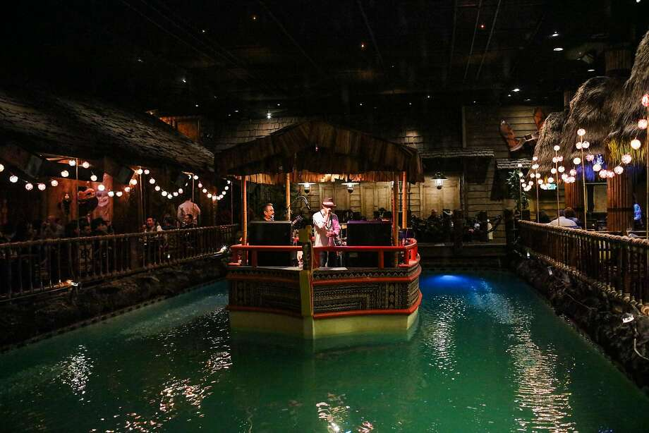 From aboard a boat in the middle of a former swimming pool, the Island Groove band does just that at the Tonga Room in S.F. Photo: Gabrielle Lurie Gabrielle Lurie, Special To The Chronicle