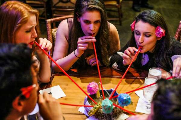 (l-r) Cristine Jessen, Casey Nuckols and Cecilia Shaw sip cocktails as they celebrate Cecilia's birthday at the Tonga Room on Friday, March 4, 2016 in San Francisco, California.