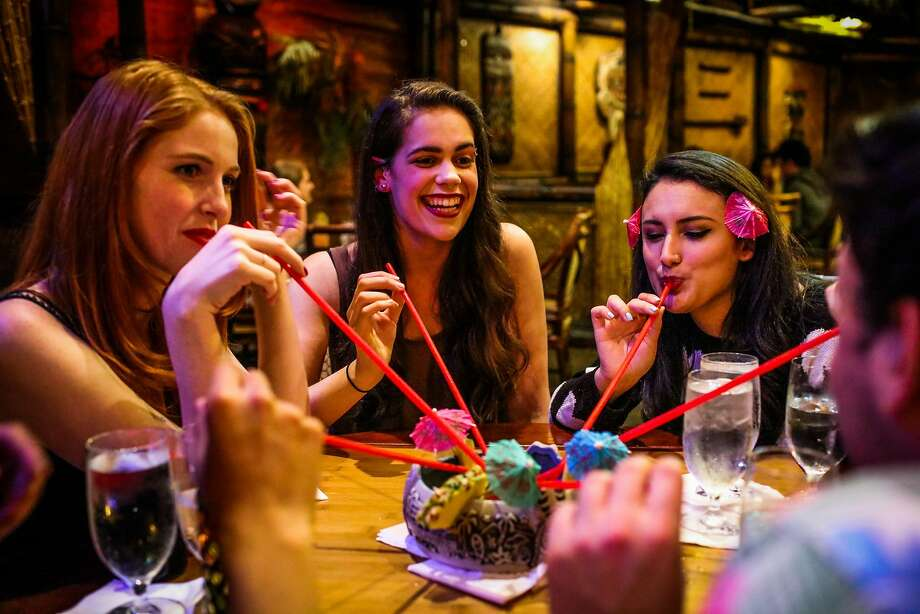 Cristine Jessen (left), Casey Nuckols and Cecilia Shaw share a cocktail to celebrate Shaw's birthday at the Tonga Room in S.F. Photo: Gabrielle Lurie Gabrielle Lurie, Special To The Chronicle