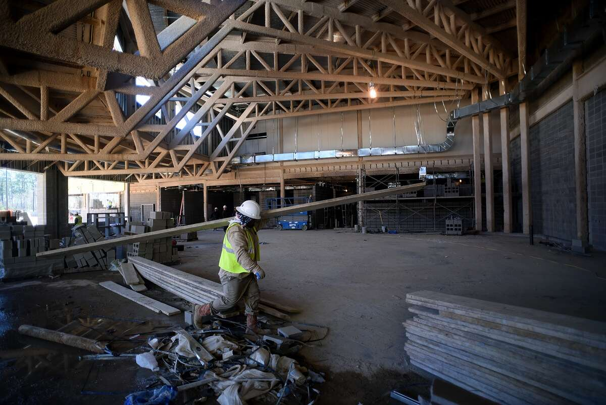 Mario Cortez of City Masonry works in the cafeteria, built with huge trusses, as construction continues on Klein ISD's Mahaffey Elem. which is due to open in the Fall of 2016. (Photo by Jerry Baker/Freelance)