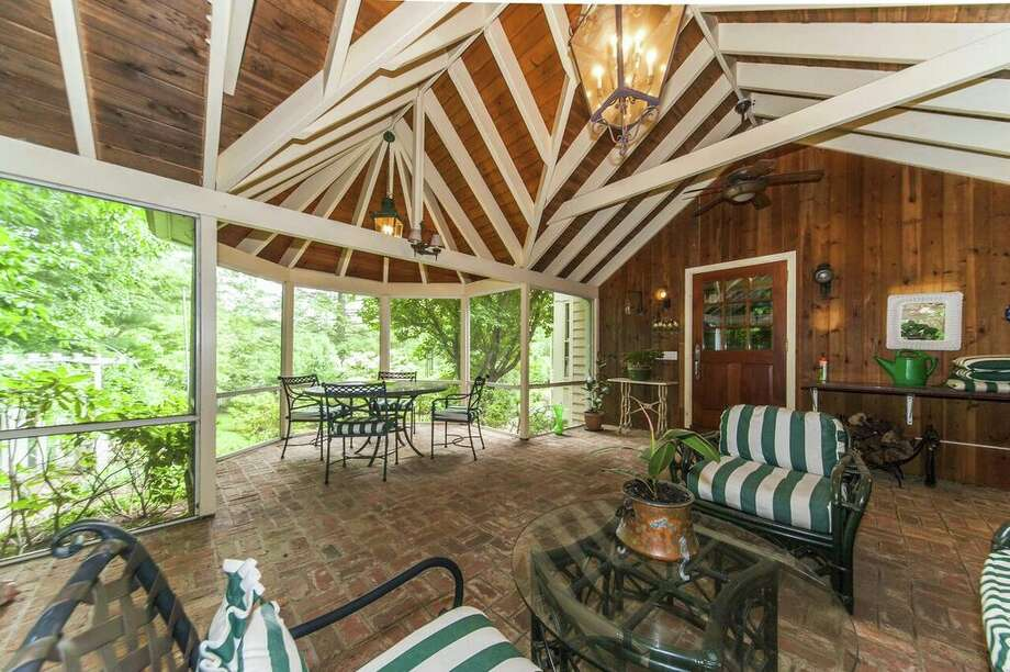 76 Saint George Ln, New Canaan, CT 06840 The porch, decks, terraces and dock overlook beautiful Lockwood Pond and the home comes with its own private island.View full listing at Houlihan Lawrence Photo: Houlihan Lawrence