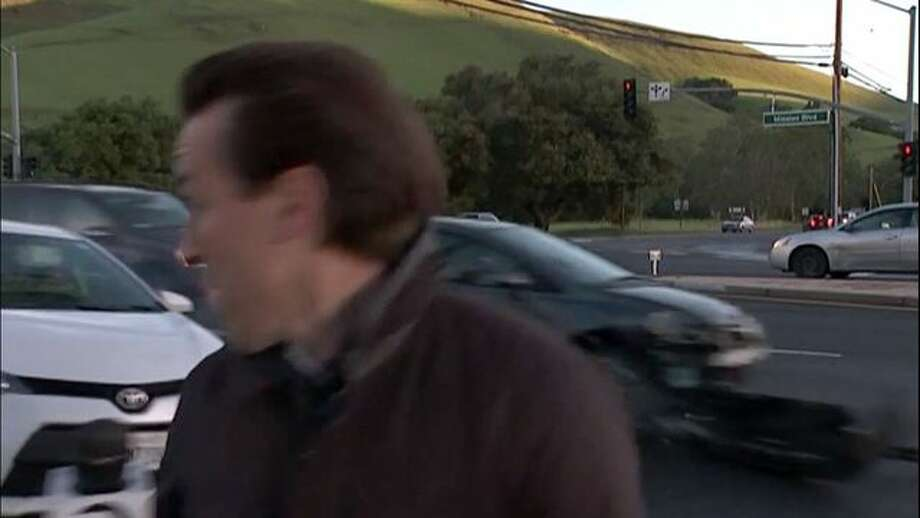 KTVU reporter Alex Savidge narrowly avoided being hit by a car that drove right through their live report Tuesday morning, March 8, 2016. Photo: KTVU