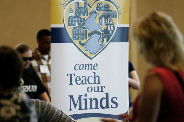 The San Antonio Independent School District holds a teacher job fair at the  Convention Center last summer. A reader defends a recent pay increase for  permanent full-time workers in the district.