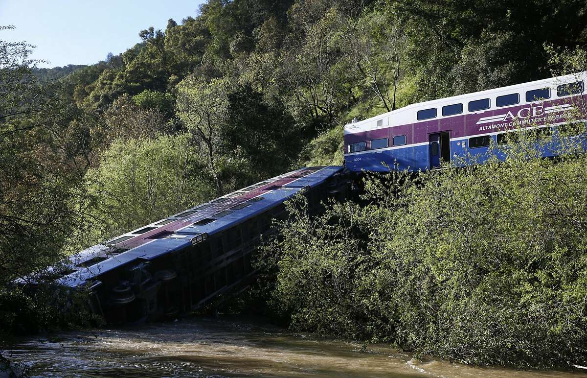 The lead car of an ACE commuter train lies on its side in Alameda Creek in Sunol, Calif. on Tuesday, March 8, 2016 after last night's derailment through Niles Canyon injured nine passengers.