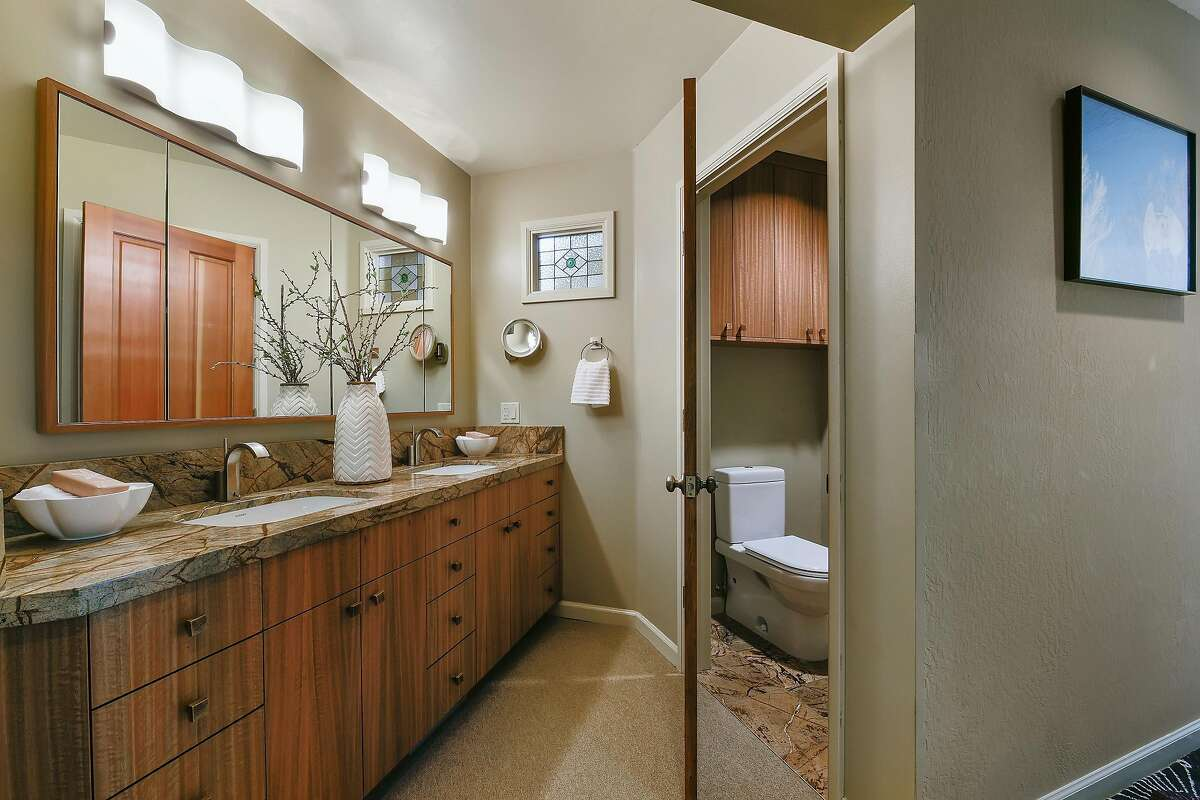 Bronze hardware accents a luxurious master bathroom that was remodeled in 2014.�