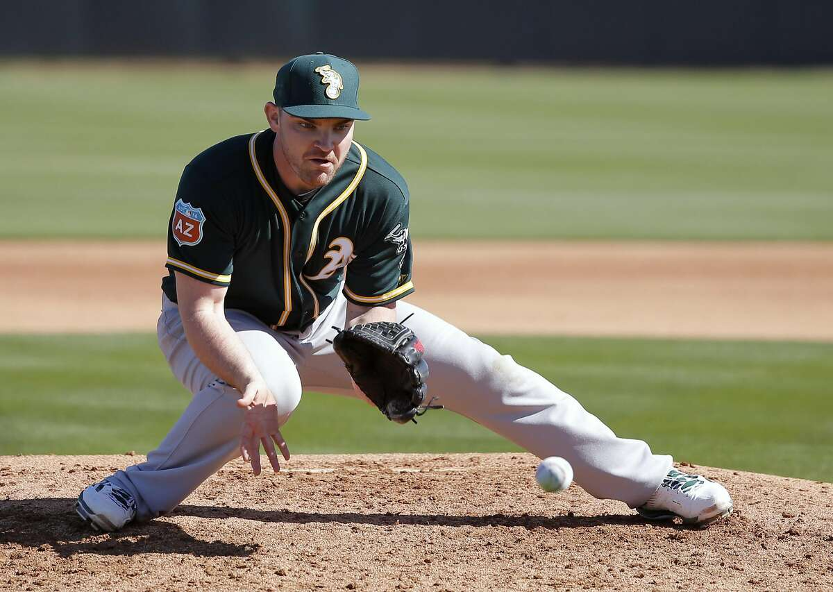 Pitcher Liam Hendriks, 31 during drills at spring training workouts for the Oakland Athletics at the Lew Wolff Training Complex in Mesa, Arizona on Thurs. February 25, 2016.