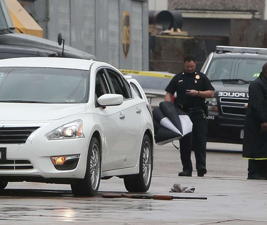A man armed with a shotgun was taken into custody after shots were fired at a package delivery facility in the 7100 block of Mykawa on March 8, 2016. Photo: Cody Duty/Houston Chronicle