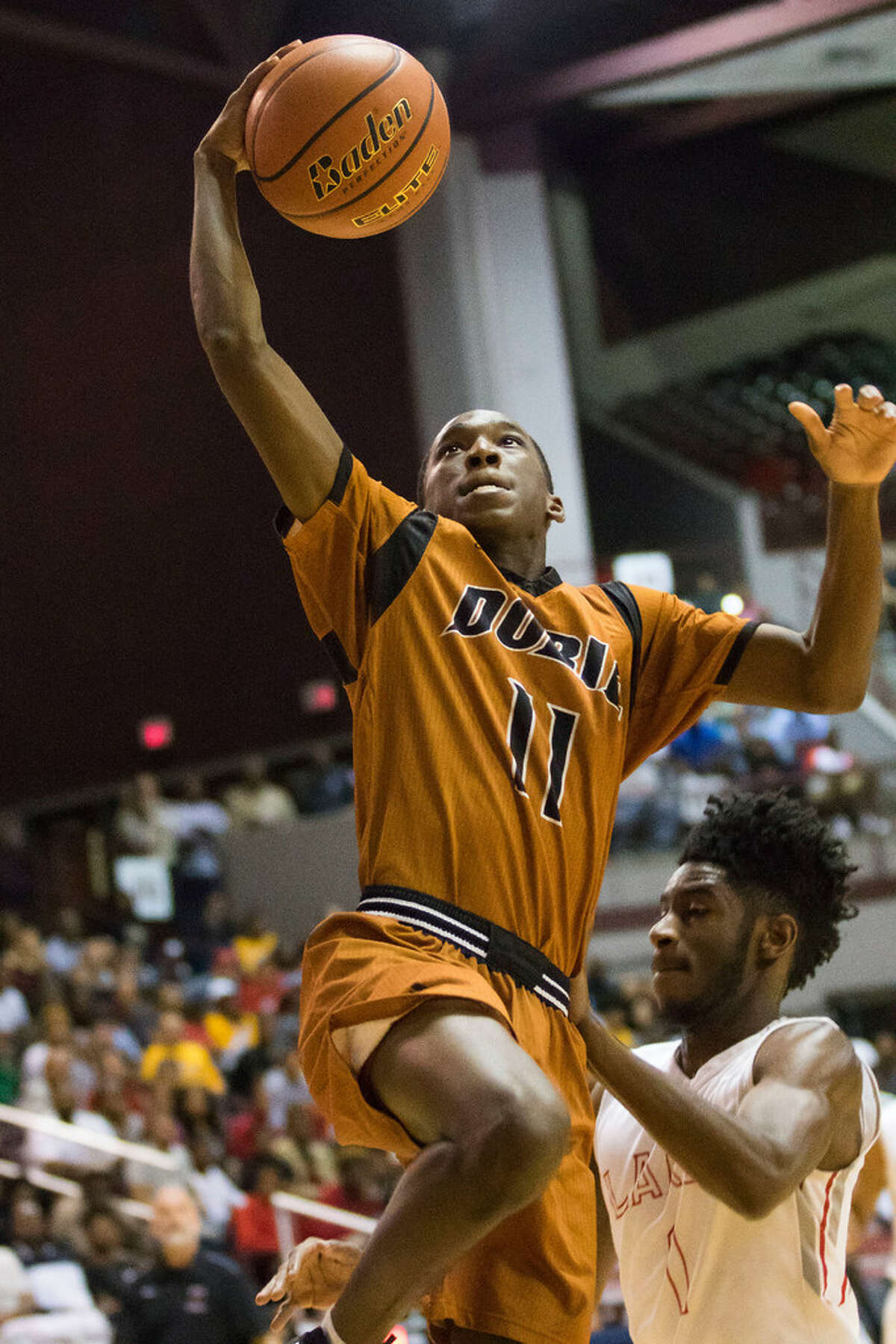 Dobie Longhorns guard Jeremy Williams (11) drives the lane for a lay up against the the Cypress Lakes Spartans' in the Class 6A Boys Basketball Region III semifinals at the Campbell Center, Friday, March 4, 2016, in Houston, TX. ( Joe Buvid / For the Chronicle )