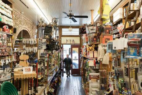A woman walks into Placerville Hardware, the second oldest business in California. Photo: James Tensuan James Tensuan, Special To The Chronicle