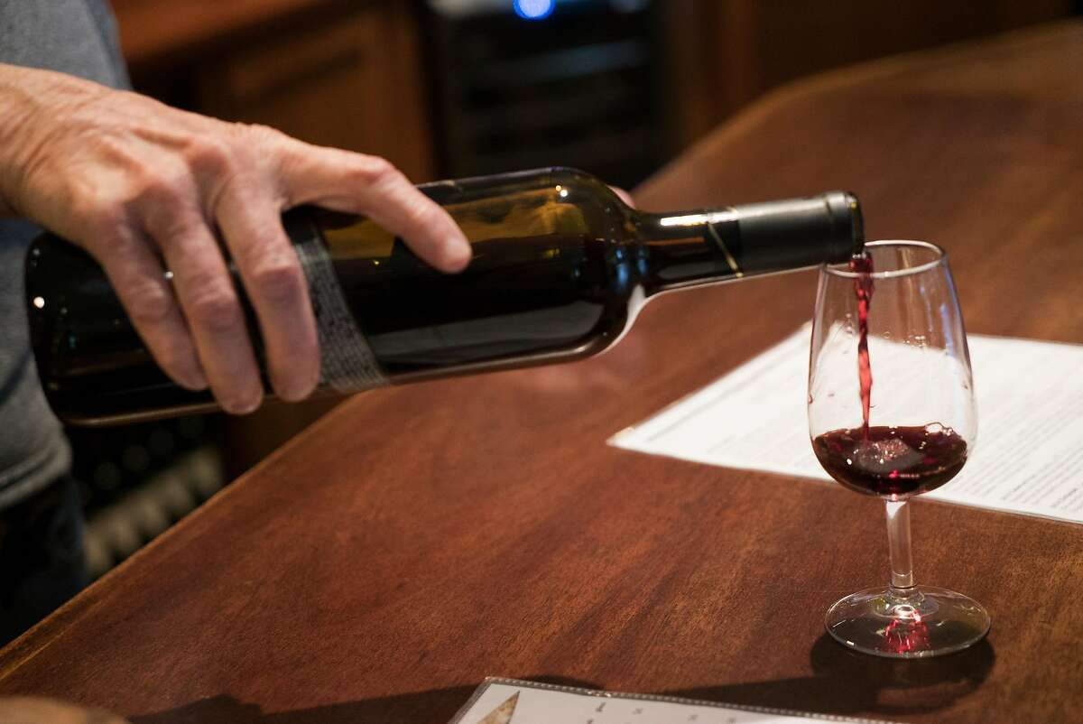 Sue Hamby pours Sarah Kamal a merlot at the Boeger tasting room in Placerville, Calif. on Friday, March 4, 2016. The long-established winery is settled in gold country.