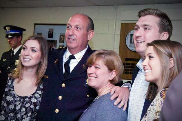 Assistant Chief Jon Fontneau poses for a photo with family and friends after being  sworn in at Stamford Police Headquarters in Stamford, Conn. on Friday April 9, 2010. Photo: Kathleen O'Rourke / Stamford Advocate