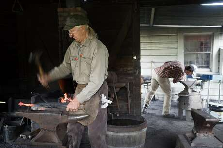 Mark Paul Kochan, left, and Brian Callen work in the blacksmith shop at the Marshall Gold Discovery State Historical Park. Photo: James Tensuan James Tensuan, Special To The Chronicle