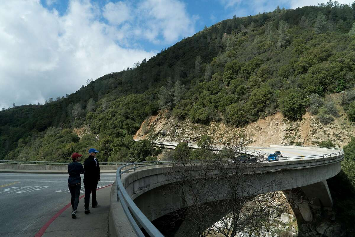 People cross Highway 49 to view the South Yuba River in Nevada City.