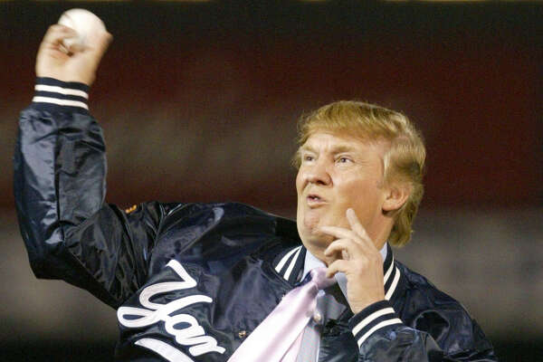 Businessman Donald Trump throws out the first pitch before the New York Yankees faced the Houston Astros, Friday, March 12, 2004, at Legends Field in Tampa, Fla. (AP Photo/Kathy Willens)