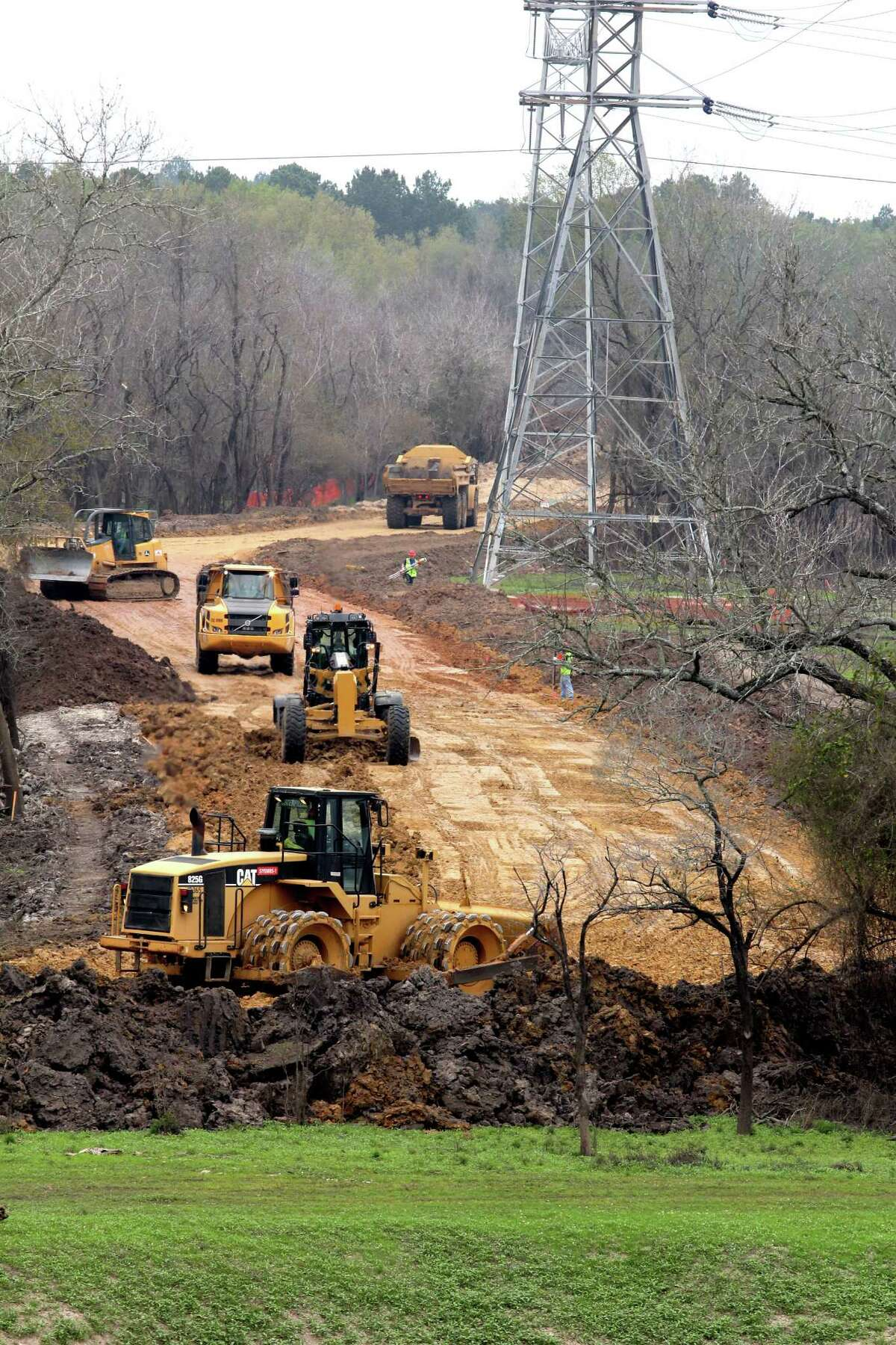 Contractors for Granite Construction Co. prepare construction haul roads so they may begin replacing water control structures at both Addicks and Barker dams.