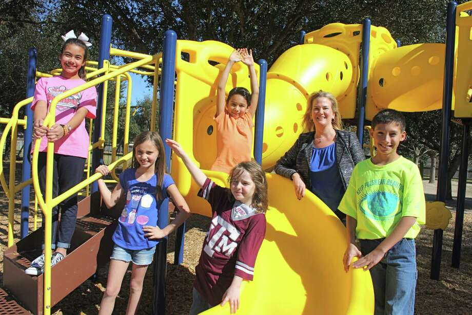 A SPARK Park will be built starting this summer at Winborn Elementary. From left are, back row: Ashlyn Duty, 11; Hunter Ondrush, 9; Kris Mitzner, principal and Ashlyn's twin brother, Blake Duty, 11; front: Allison Slaten, 9, and Layla Hansen, 7. Photo: Suzanne Rehak, Freelance Photographer