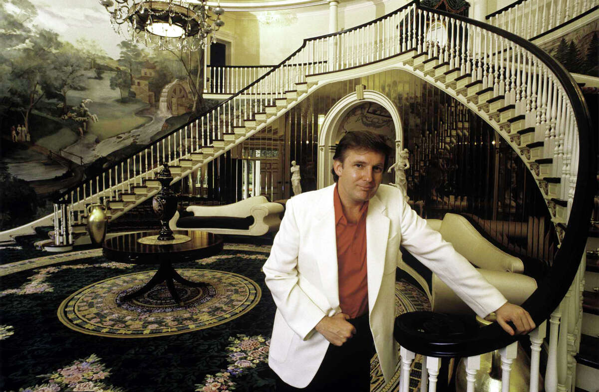 Donald Trump, real estate mogul, entrepreneur, and billionare poses in the foyer of his home in August 1987 in Greenwich, Connecticut.