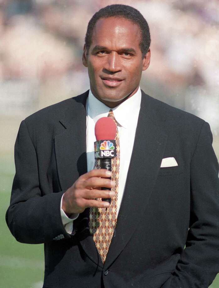 O.J. Simpson aka Orenthal James Simpson serves as a NBC Sports sideline reporter for AFC Wild Card playoff game between the Denver Broncos and Oakland Raiders at the Los Angeles Memorial Coliseum on Jan. 9, 1994. (Photo by Kirby Lee/WireImage) Photo: Kirby Lee, Getty Images / WireImage