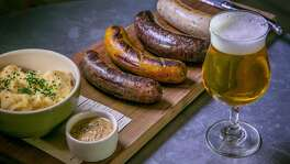 The Sausage Board with Belgian mash and a beer at Belga in San Francisco, Calif., is seen on July 7th, 2015.