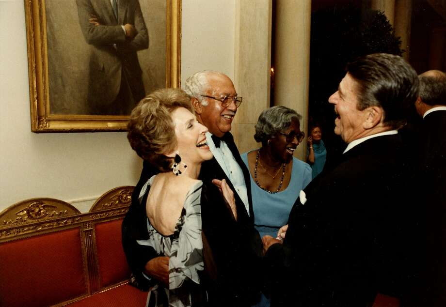 """First lady Nancy Reagan and President Ronald Reagan greet  John Woodson Ficklin and his wife Sarah at the 1983 state dinner for the amir of Bahrain. Ficklin was the first member of the residence staff to ever attend a state dinner—even before Eugene Allen, the inspiration for the movie """"Lee Daniels' The Butler."""" MUST CREDIT: White House handout Photo: White House, The White House"""