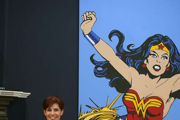 Jenny Dearborn shows her painting of a wonder woman cartoon displayed at home in Palo Alto, California, on Wednesday, February 24, 2016.  She has four degrees including Stanford and UC Berkeley, has 75,000 employees worldwide, and paints superheroes in her spare time.