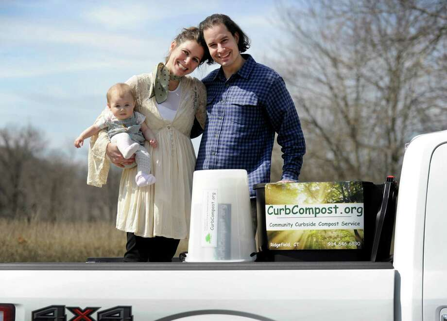Nick and Erica Skeadas, 35, holding baby Genevieve, six-months-old, of Ridgefield, have started a new business, Curbside Compost.  Photo Tuesday, March 8, 2016. Photo: Carol Kaliff / Hearst Connecticut Media / The News-Times