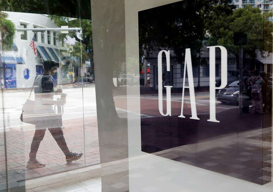 In this Saturday, Aug. 15, 2015, photo, a pedestrian walks past a Gap store in Miami. Gap reports earnings on Thursday, Feb. 25, 2016. (AP Photo/Lynne Sladky) Photo: Lynne Sladky, AP