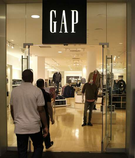 In this Feb. 20, 2011 photo, shoppers enter a Gap store is shown in Dallas. Gap Inc. releases quarterly financial results after the market closes.(AP Photo/LM Otero) Photo: LM Otero, AP