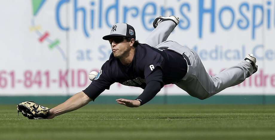 New York Yankees center fielder Dustin Fowler dives but cannot catch a single hit by Miami Marlins' Don Kelly during the seventh inning of an exhibition spring training baseball game Tuesday, March 8, 2016, in Jupiter, Fla. The Marlins won 1-0. (AP Photo/Jeff Roberson) Photo: Jeff Roberson, AP