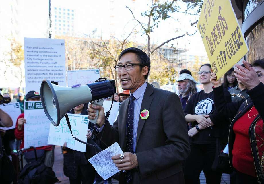 Supervisor Eric Mar (center) speaks to a crowd of students and educators during a protest opposing CCSF's new budget cuts at UN Plaza in San Francisco, California on Thursday, November 12, 2015. He is now proposing a new tax on technology companies in San Francisco. Photo: Gabrielle Lurie, Special To The Chronicle