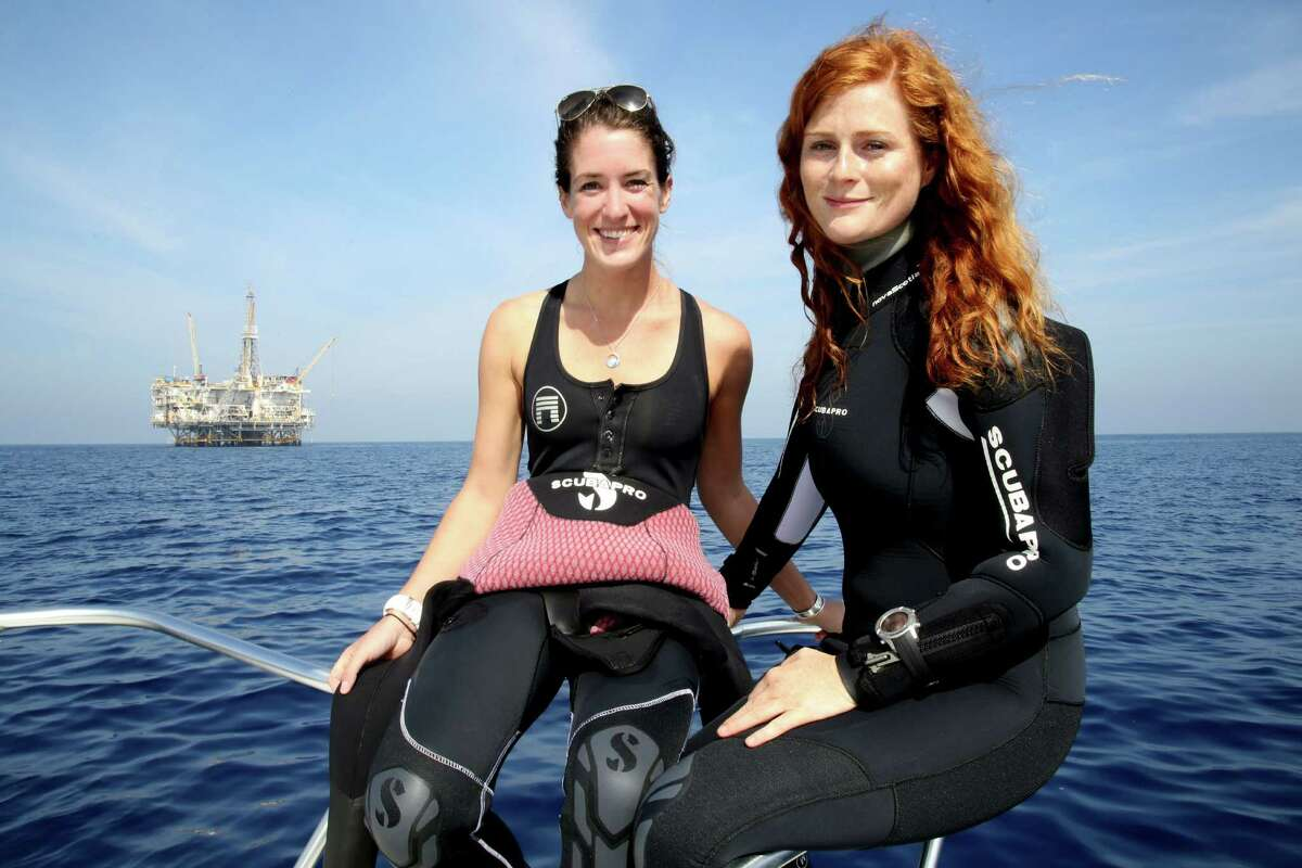 Emily Callahan, left, and Amber Jackson are touting the value of old oil rigs as homes for sea life.