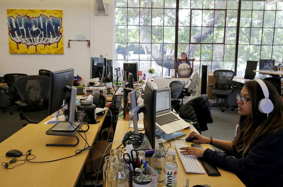 Shamila Zindani, 25, an online marketing manager at Atlassian, works at her desk in the company's San Francisco office. Atlassian recently commissioned a survey of tech workers' attitudes about diversity. Photo: Leah Millis Leah Millis, The Chronicle