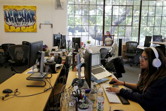 Shamila Zindani, 25, Online Marketing Manager for HipChat & Confluence does work at her desk inside the office of Atlassian March 8, 2016 in San Francisco, Calif.