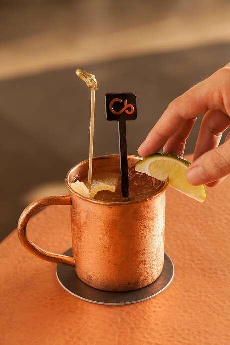 The signature Mauna Kea mule, right, comes in a copper mug at the Mauna Kea Beach Hotel's recently opened Copper Bar. Photo: Mauna Kea Beach Hotel