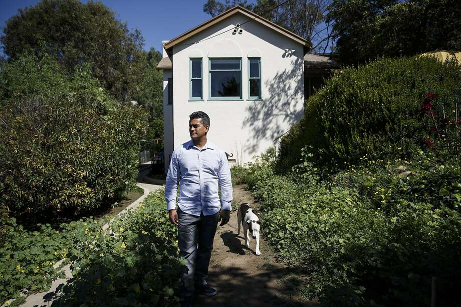 """Franky Carrillo, arrested at age 16 and wrongly convicted in 1991 of murder before spending 20 years in prison, stands for a portrait outside his home on Tuesday, March 8, 2016 in the Echo Park neighborhood of Los Angeles, Calif. Carrillo said that while in prison the photographs he received in the mail from family and friends were very important to him. """"These pictures (were) moments in people's lives that people would send me... I would sort of grow with them and feel that I was there,"""" said Carrillo. """"They reminded me that I was aging along with the people that were on the outside."""" Photo by Patrick T. Fallon/Special to The Chronicle Photo: Patrick T. Fallon Patrick Fallon, Special To The Chronicle"""