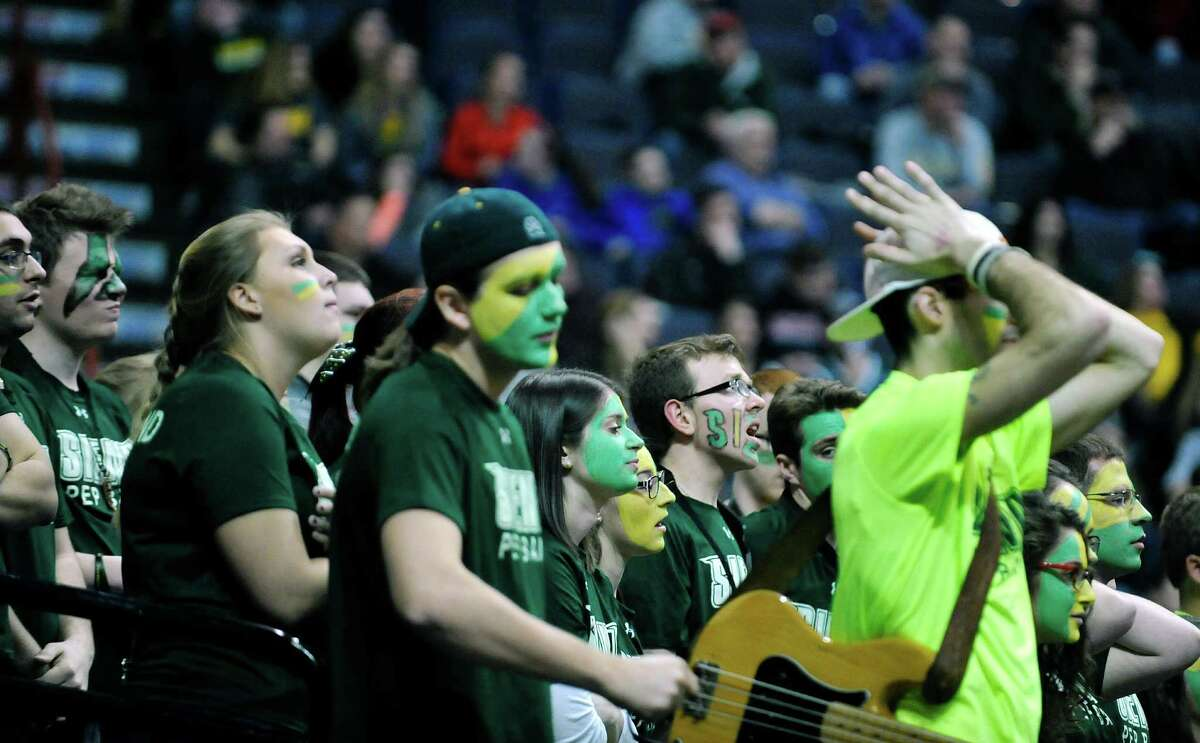 Siena fans react as an Iona player makes a three-point shot during their MAAC Tournament game on Sunday, March 6, 2016, in Albany, N.Y. (Paul Buckowski / Times Union)